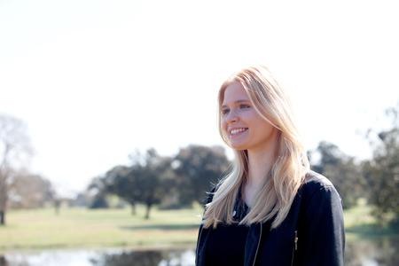 good time: Cool blonde girl enjoying of good time at spring Stock Photo