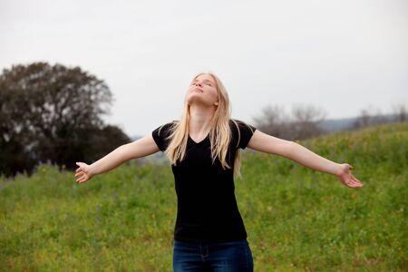 good time: Blonde girl enjoying of good time at spring Stock Photo