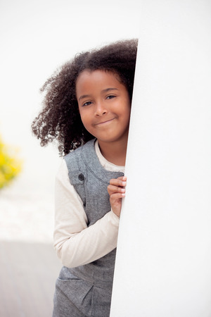 eight years old: Pretty girl eight years old with beautiful afro hair Stock Photo