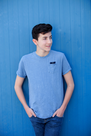 rebellious: Portrait of a teenager rebellious man with a blue background