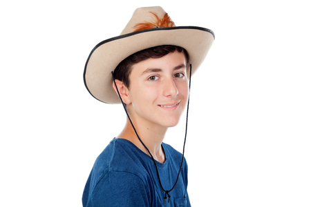 complement: Teenager boy with a cowboy hat isolated on a white background Stock Photo