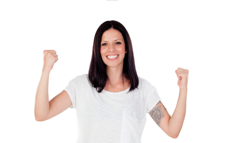 latinamerican: Excited brunette woman celebrating a triumph - isolated over a white background Stock Photo