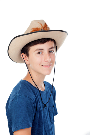 Teenager boy with a cowboy hat isolated on a white background Stock Photo