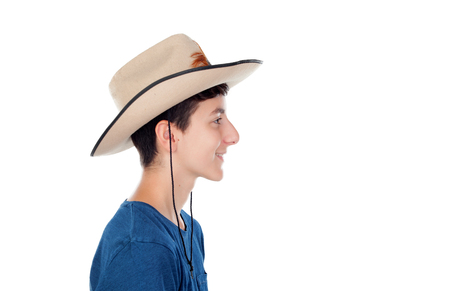 poised: Teenager boy with a cowboy hat isolated on a white background Stock Photo