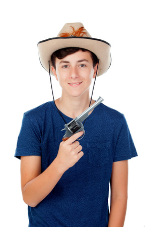 poised: Teenager boy with a cowboy hat and a gun isolated on white background