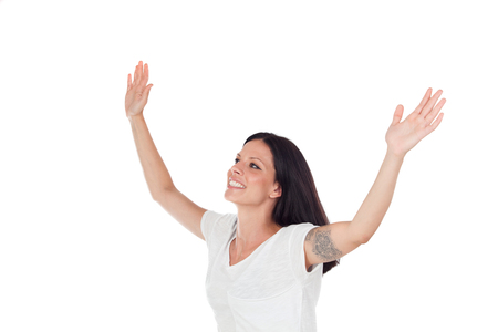 Excited brunette woman celebrating a triumph - isolated over a white background Stock Photo