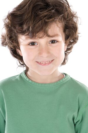 six years: Smiling boy with six years old looking at camera isolated on a white background Stock Photo