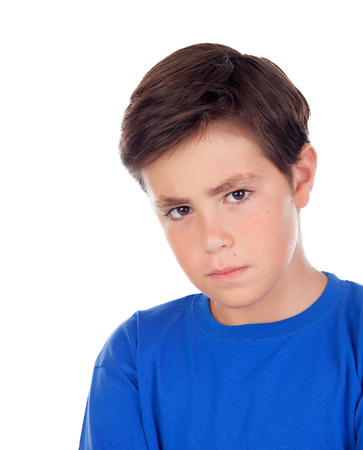 Angry child with ten years old and blue t-shirt isolated on a white background Stock Photo