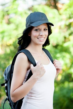 Pretty brunette woman hiking in her spare time