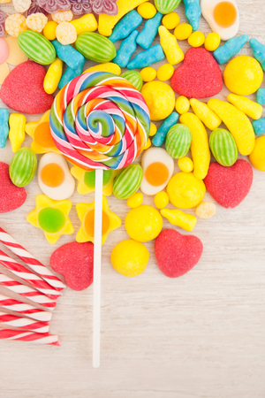 Candies with different shapes and colors on a gray wooden background Stock Photo