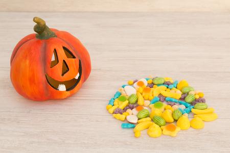 Orange pumpkin halloween with many baubles. Stock Photo