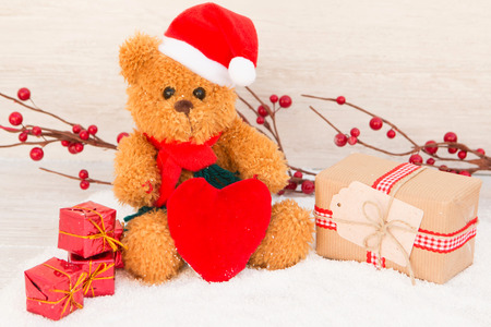 bear berry: Cute teddy bear with red hat. Christmas atmosphere