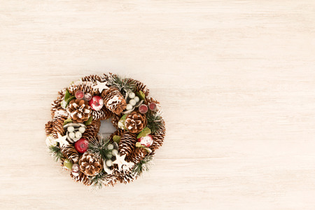 Delicate Christmas wreath of pine cones on gray wooden background Stock Photo