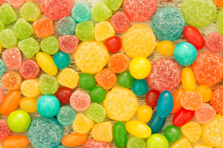 jelly beans: Colorful jelly beans of different sizes close to wallpaper