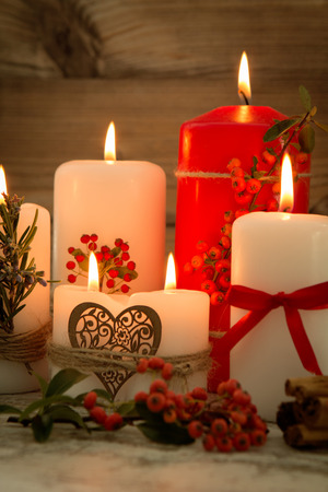 brighten: Elegant candles decorated for Christmas. Brighten up your illusion