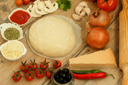 Ingredients for preparing a vegetarian pizza Stock Photo