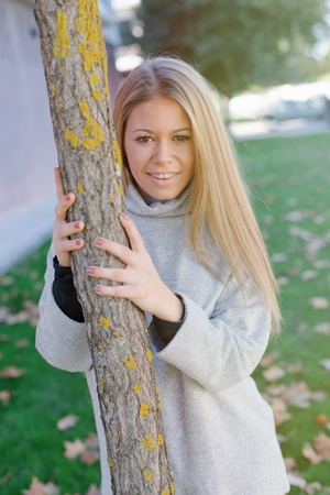 leafed: Pretty blonde girl in the park at autumn