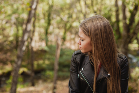 misterious: Pensive woman in a beautiful forest in autumn