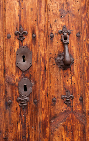 Nice old door with wrought iron decoration Stock Photo