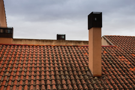 proprietary: Roof with reddish tiles and chimneys with metallic cover