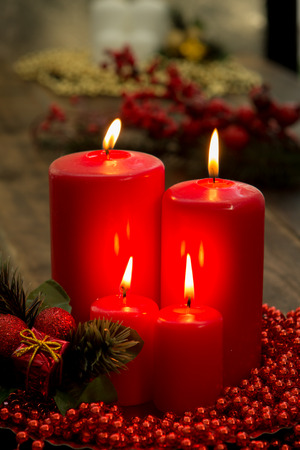 Red candles for Christmas with a beautiful decoration Banco de Imagens - 66352755