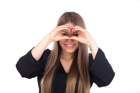 looking through: Attractive blonde girl looking through her hands isolated on a white background Stock Photo