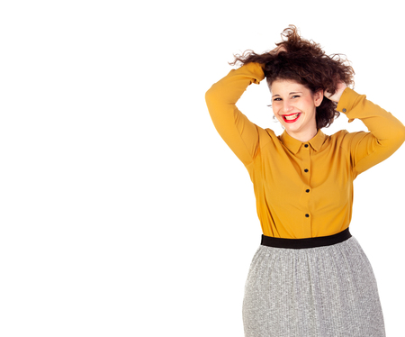 Happy overweight girl touching her hair isolated on a white background