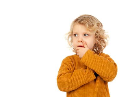 imagining: Small blond child imagining something isolated on a white background