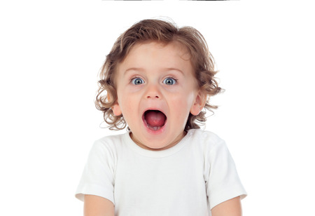 Surprised baby with blue eyes isolated on a white background
