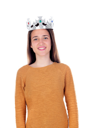 Smiling teenager girl with silvered crown on her head isolated on a white background