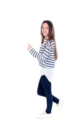 Active teenager girl walking with striped t-shirt isolated on a white background Stock Photo