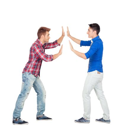 Two guys pushing against isolated on a white background