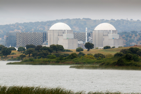 Almaraz, nuclear power plant in the center of Spain, surrounded by a green field 版權商用圖片 - 77565006