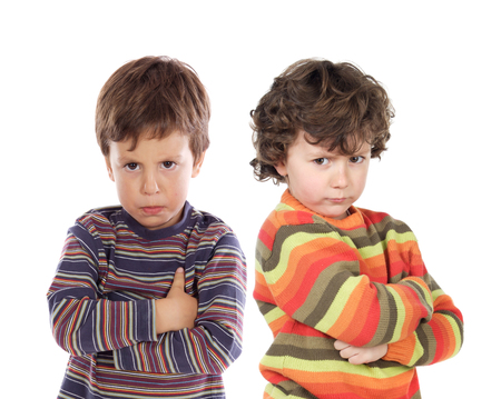 Couple of angry children isolated on a white background