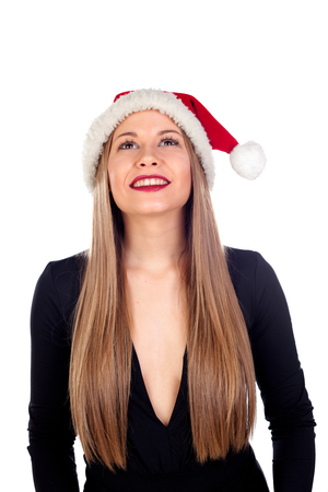 misterious: Young woman with Christmas hat and red lips isolated on a white background