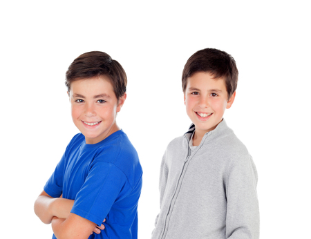 Two teenager boys isolated on a white background photo