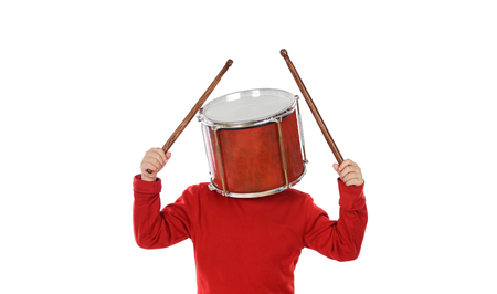Child with a drum on the head isolated over white background photo