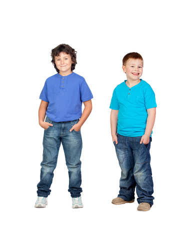 Two children in blue isolated on a white background photo