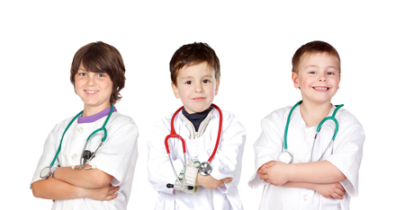 Three small doctors isolated on a white background photo