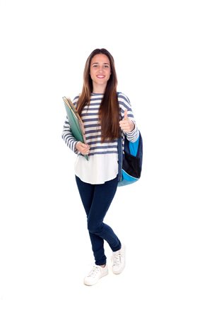 Teenager student girl isolated on a white background photo
