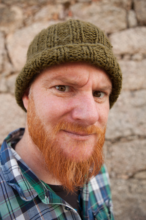 Portrait of a red haired hipster guy putting silly face  Stock Photo