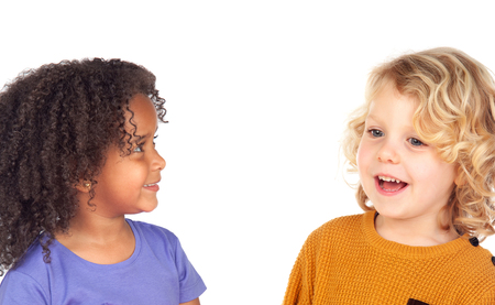 Two adorable children looking at each other isolated on a white background photo