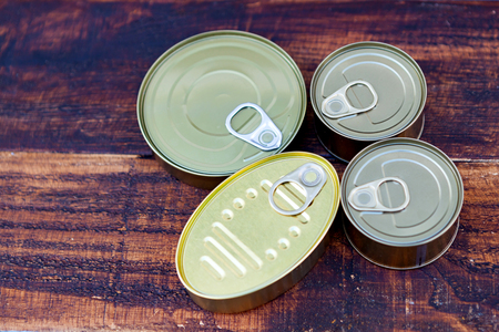 aluminium: Cans of preserves on an aged wooden background