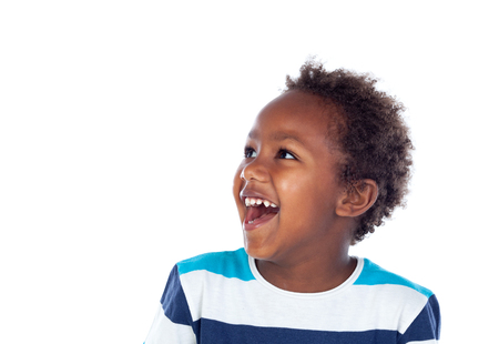 Surprised boy laughing out loud isolated on a white background