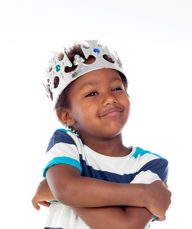 Happy african child with silvered crown isolated on a white background Stock Photo