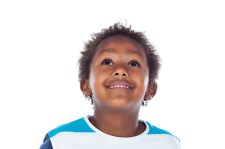 afroamerican: Adorable afroamerican child looking up isolated on a white background