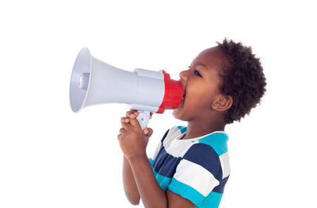 proclaim: Small boy shouting through a megaphone isolated on white background