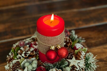 chandelier background: Candle for Christmas in red. Beautiful Holidays decoration