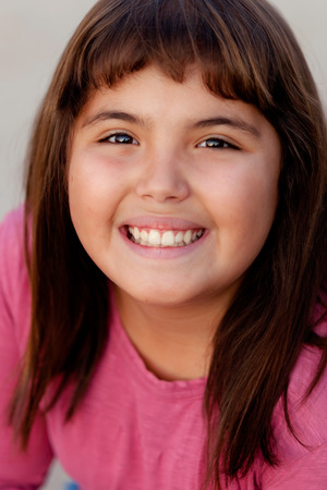 Portrait of a brunette preteen girl with pink t-shirt