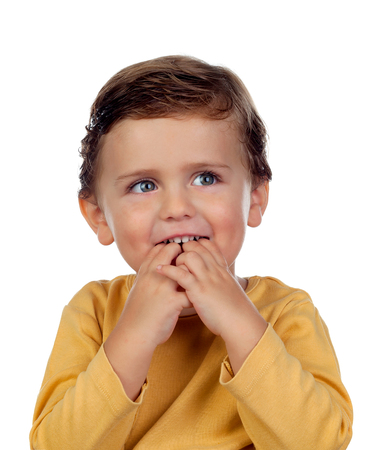 Adorable small child two years old sucking his hand Stock Photo